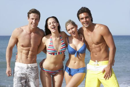 seaside: Group Of Friends Enjoying Beach Holiday