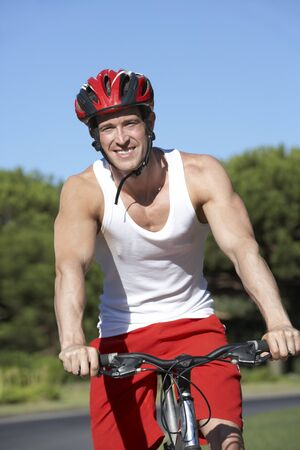 vertica: Man On Cycle Ride