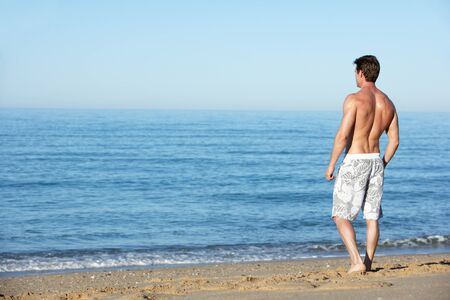 swimshorts: Young Man Standing On Summer Beach