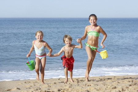 11 year old girl: Group Of Children Enjoying Beach Holiday