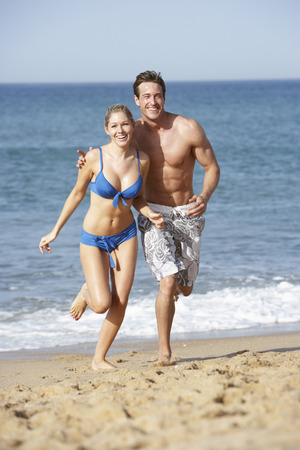 beach holiday: Young Couple Enjoying Beach Holiday Stock Photo