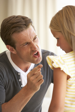 reprimanding: Father Telling Off Daughter At Home