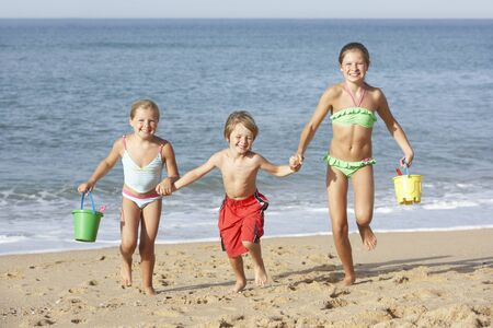 11 year old: Group Of Children Enjoying Beach Holiday