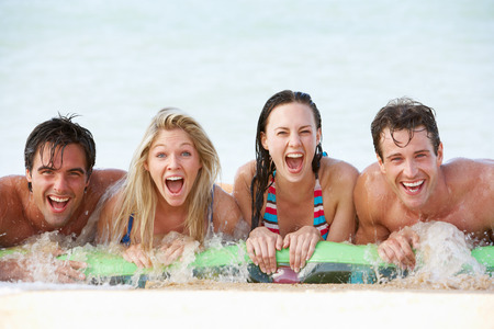 lilo: Group Of Friends Having Fun In Sea On Airbed