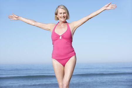summer beach: Senior Woman Standing On Summer Beach