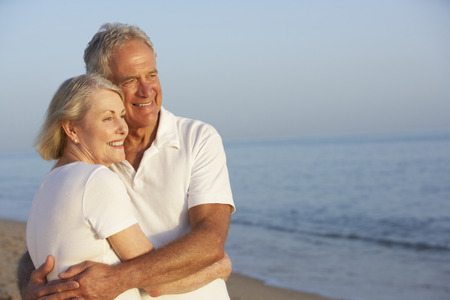 Senior Couple Enjoying Beach Holiday Banco de Imagens