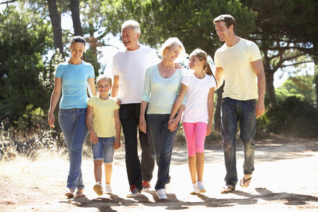 extended family: Three Generation Family On Summer Countryside Walk Together