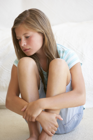 11 year old girl: Portrait Of Unhappy Young Girl At Home