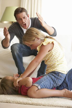reprimand: Children Fighting In Front Of Father At Home