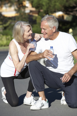 Senior Couple Resting And Drinking Water After Exercise Stock Photo - 42400463