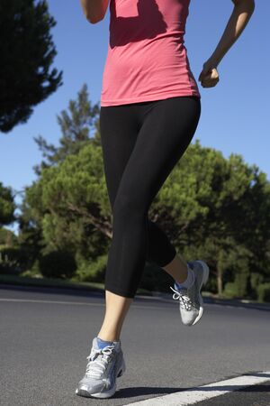 jogging track: Close Up Of Woman Running On Road
