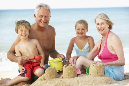beach holiday: Grandparents And Grandchildren Enjoying Beach Holiday