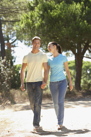 countryside loving: Young Couple On Romantic Walk In Countryside