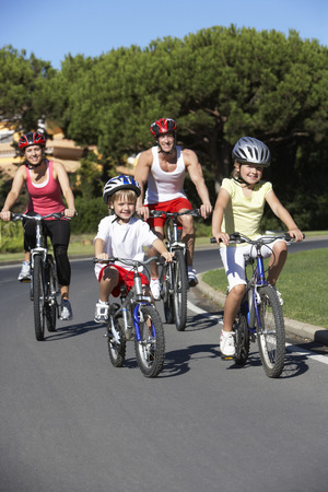 Family On Cycle Ride Together Stock Photo