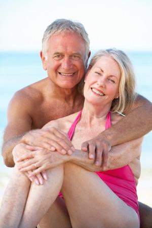 senior women: Senior Couple Enjoying Beach Holiday Stock Photo