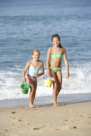 11 year old girl: Two Young Girls Enjoying Beach Holiday Stock Photo