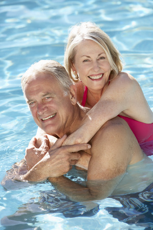 Senior Couple Relaxing In Swimming Pool Together Stok Fotoğraf - 42400511