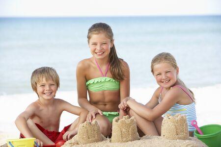 beach holiday: Group Of Children Enjoying Beach Holiday