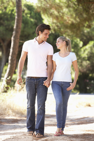 path to romance: Young Couple On Romantic Walk In Countryside