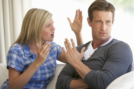 arguement: Young Couple Having Argument At Home