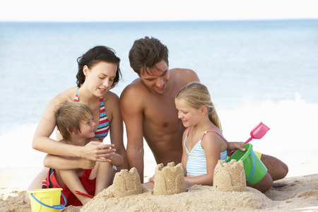sandy beach: Portrait Of Family Enjoying Beach Holiday Stock Photo