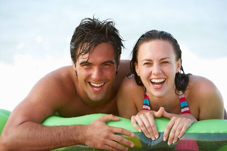 lilo: Young Couple Having Fun In Sea On Airbed Stock Photo