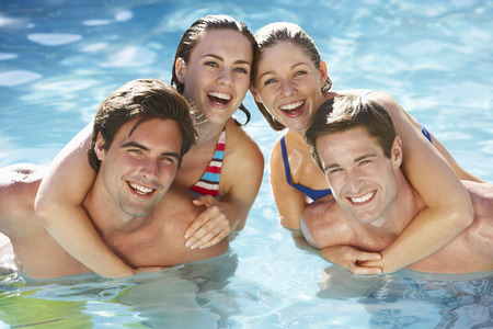 thirties portrait: Group Of Friends Relaxing In Swimming Pool Together