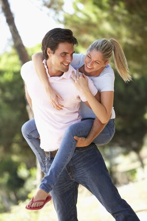 countryside loving: Young Couple Having Fun On Countryside Walk Stock Photo