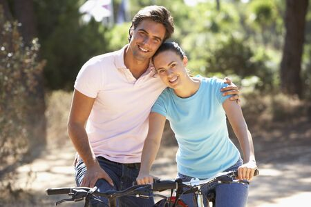 men and women: Couple On Cycle Ride Together Stock Photo