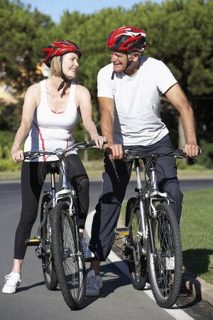 cycle ride: Senior Couple On Cycle Ride Together