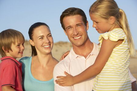 family portrait: Portrait Of Young Family On Beach Holiday Stock Photo