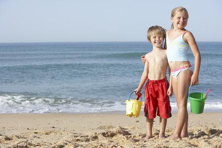 9 year old girl: Boy And Girl Enjoying Beach Holiday
