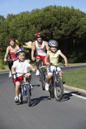 family outside: Family On Cycle Ride Together Stock Photo