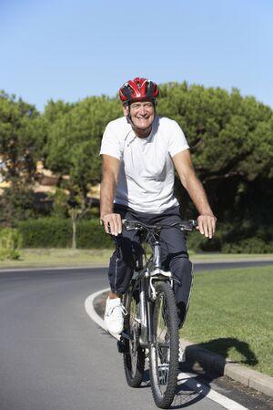 vertica: Senior Man On Cycle Ride