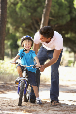dad son: Father Teaching Son To Ride Bicycle