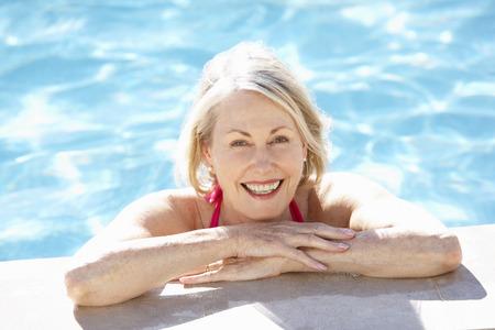 Senior Woman Relaxing In Swimming Pool