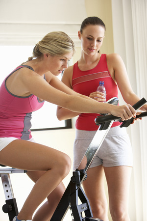 home trainer: Young Woman On Exercise Bike With Trainer