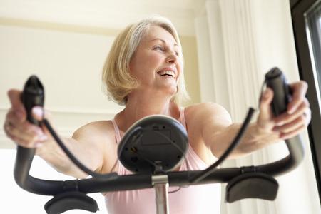 3 generation: Senior Woman On Exercise Bike
