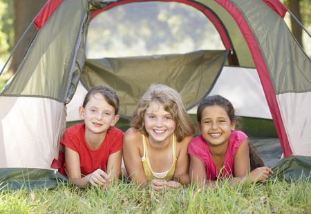 girls having fun: Group Of Girls Having Fun In Tent In Countryside