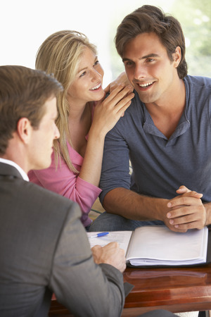 financial advisor: Couple Meeting With Financial Advisor At Home