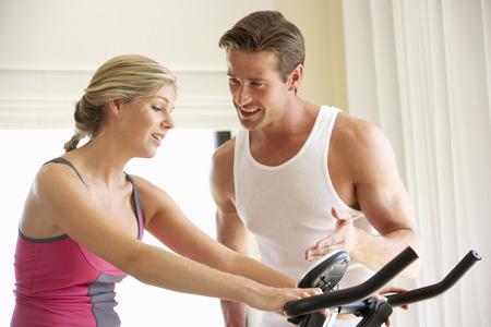lilo: Young Couple On Exercise Bike Stock Photo