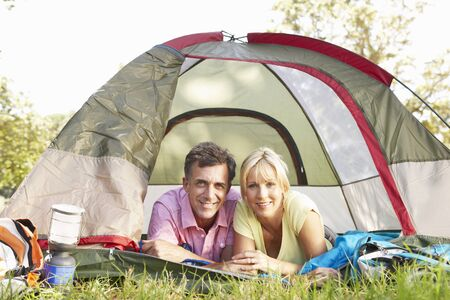 middle aged couple: Middle Aged Couple On Camping Holiday In Countryside