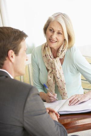 Senior Woman Meeting With Financial Advisor At Home Stock fotó