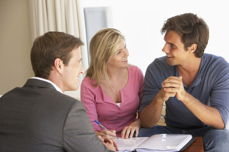financial advice: Couple Meeting With Financial Advisor At Home