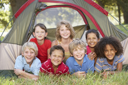 camping tent: Group Of Children Having Fun In Tent In Countryside