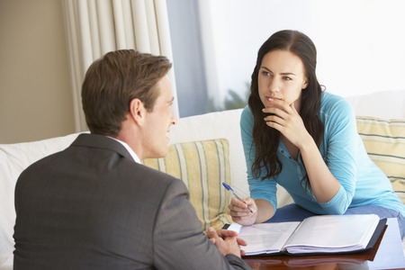 financial advisor: Woman Meeting With Financial Advisor At Home