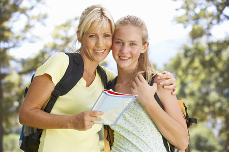 Mother And Daughter Hiking Through Countryside photo