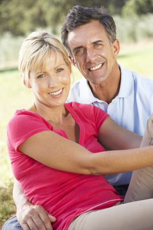 countryside loving: Middle Aged Couple Relaxing In Countryside Stock Photo