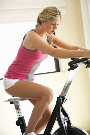 lilo: Young Woman On Exercise Bike