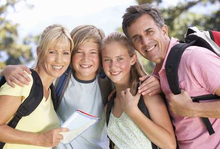 Middle Aged Family Hiking Through Countryside Banque d'images